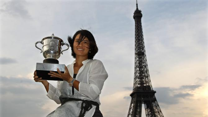 File photo of Li Na of China posing with her trophy near the Eiffel Tower in Paris after winning the French Open tennis tournament