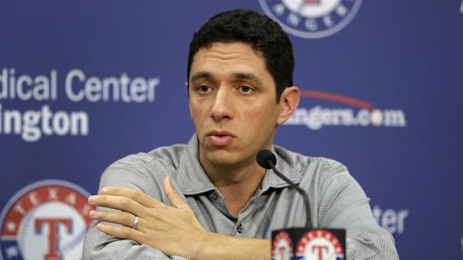 Texas Rangers president of baseball operations and general manager Jon Daniels responds to a reporters questions during a news conference where the team announced that they had agreed to terms with designated hitter Manny Ramirez on a minor league contract before a baseball game against the Seattle Mariners, Wednesday, July 3, 2013, in Arlington, Texas. Ramirez has been assigned to the team's Triple-A Round Rock Express team. (AP Photo/Tony Gutierrez)