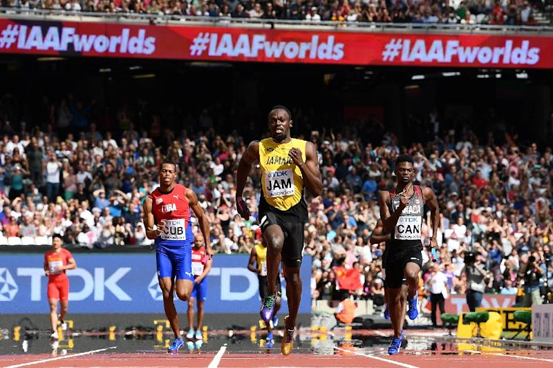 Jamaica's Usain Bolt (C) race to victory on the anchor leg ahead of Canada's Mobolade Ajomale (R) and Cuba's Jose Luis Gaspar to win their heat in the 4x100m relay at the IAAF World Championships at the London Stadium in London, on August 12, 2017