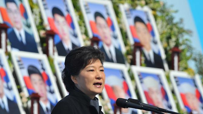 "South Korean President Park Geun-hye delivers a speech during the third anniversary of the sinking of a South Korean naval war ship ""Cheonan,"" at the National Cemetery in Daejeon, South Korea, March 25, 2013. An explosion ripped apart the 1,200-ton warship, killing 46 sailors near the maritime border with North Korea in 2010. (AP Photo/Kim Jae-hwan, Pool)"