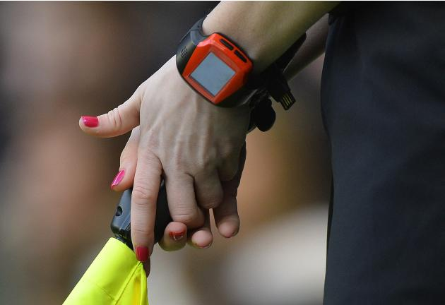 Assistant referee Sian Massey officiates during the English Premier League soccer match between Chelsea and Newcastle United in London