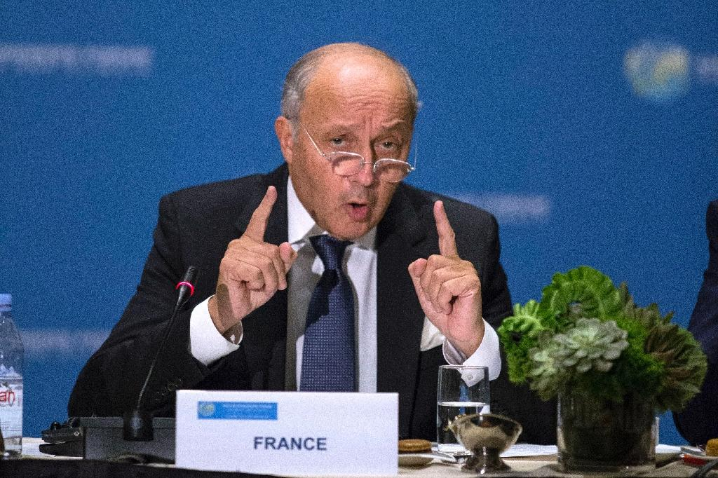 France's Fabius urges stragglers to publish emissions data