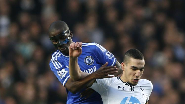 Tottenham Hotspur's Bentaleb challenges Chelsea's Ramires during their English Premier League soccer match at Stamford Bridge in London