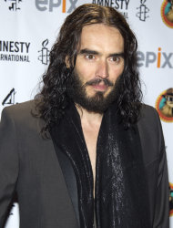 "FILE - In this March 4, 2012 file photo, Russell Brand arrives to Amnesty International's ""Secret Policeman's Ball"" in New York. MTV network says the 36-year-old comedian will host the 2012 MTV Movie Awards June 3, 2012. (AP Photo/Charles Sykes, file)"