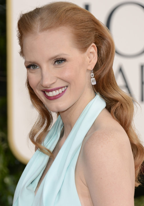 Golden Globes 2013 red carpet: Jessica Chastain wore her red locks pinned back with curled locks hanging down her back ©Getty