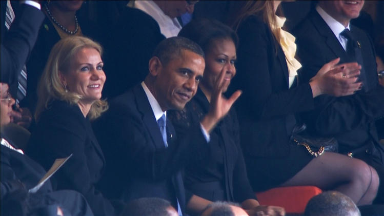 U.S. President Obama waves to the crowd during Mandela's national memorial service in Johannesburg