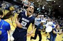 Mount St. Mary's Julian Norfleet (23) celebrates as fans rush the court following a win over Robert Morris during Northeastern Conference championship NCAA college basketball game on Tuesday, March 11, 2014, in Coraopolis, PA. Mt. Saint Mary won 88-71.(AP Photo/Don Wright)