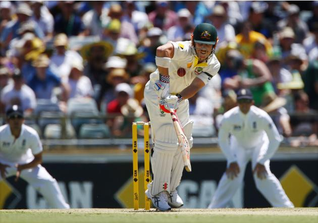 Australia's Warner is struck by a delivery from England's Anderson during the first day's play of the third Ashes cricket test match at the WACA in Perth