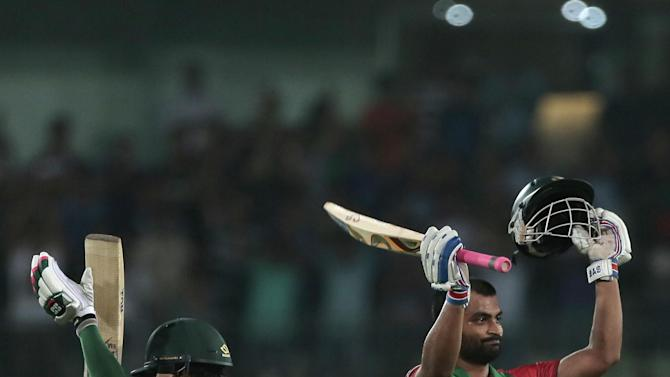 Bangladesh's Tamim Iqbal, right, celebrates with teammate Mushfiqur Rahim  after scoring hundred during the second one-day international cricket match against Pakistan in Dhaka, Bangladesh, Sunday, April 19, 2015. (AP Photo/ A.M. Ahad)