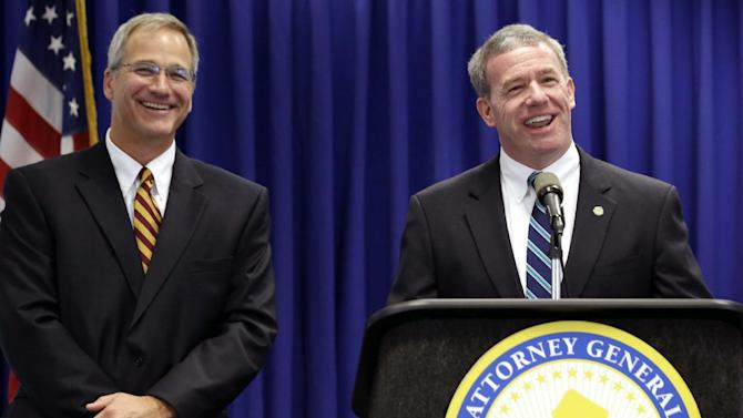 """New Jersey Attorney General Jeffrey Chiesa, right, and Michael Halfacre, chief of the New Jersey Division of Alcoholic Beverage Control, talk about an investigation dubbed """"Operation Swill,"""" in which 29 bars and restaurants in New Jersey are accused of putting cheap booze in premium brand liquor bottles and selling it, during a news conference, Thursday, May 23, 2013, in Trenton, N.J. Thirteen of the restaurants cited are TGI Fridays located in central and northern New Jersey. (AP Photo/Julio Cortez)"""