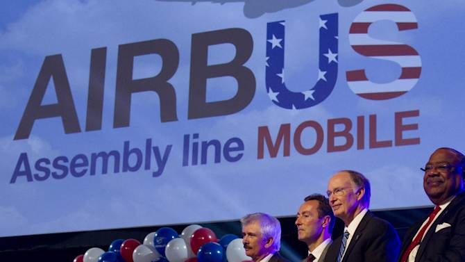 Officials attend ceremonies announcing that Airbus will establish its first assembly plant in the United States in Mobile, Ala., Monday, July 2, 2012. From left: Barry Eccleston, Airbus President & CEO Fabrice Bregier, Alabama Gov. Robert Bentley and Mobile, Ala. Mayor Sam Jones. The French-based company said the Alabama plant is expected to cost $600 million to build and will employ 1,000 people when it reaches full production, likely to be four planes a month by 2017. (AP Photo/Dave Martin)