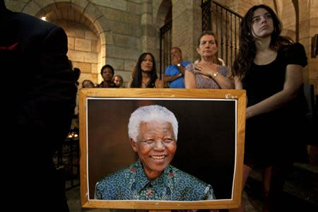 People attend a special Sunday service dedicated to Nelson Mandela at St. George's Cathedral in Cape Town