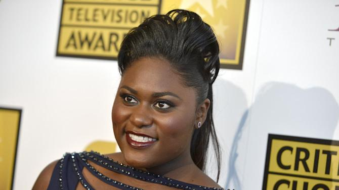 "FILE - In a Thursday, June 19, 2014 file photo, actress Danielle Brooks arrives at the Critics' Choice Television Awards at the Beverly Hilton Hotel, in Beverly Hills, Calif. Brooks is going from orange to purple _ jumping from ""Orange Is the New Black"" on TV to a Broadway stage in the upcoming ""The Color Purple"" revival. Performances start Nov. 9, 2015, at the Bernard B. Jacobs Theatre. The musical is a stage version of Alice Walker's Pulitzer Prize-winning novel. (Photo by Richard Shotwell/Invision/AP)"