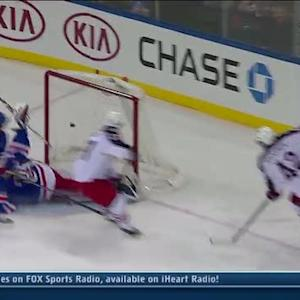 Artem Anisimov chips a shot past Lundqvist