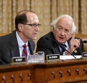 "House Ways and Means Committee Chairman Rep. Dave Camp , R-Mich., left, and the committee's ranking member, Rep. Sander Levin, D-Mich., exchange words on Capitol hill in Washington, Wednesday, April 9, 2014, during a disagreement over procedure as the panel debates whether IRS official Lois Lerner's refusal to testify to Congress deserves criminal prosecution. After Rep. Levin's insistence that he, the top Democrat, be heard, Chairman Camp told Levin to ""chill out."" Levin replied that he was ""very chilled out."" Ways and Means wants the Justice Department to open a criminal probe against Lerner. (AP Photo/J. Scott Applewhite)"