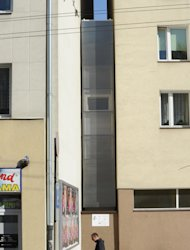 A passerby walks past one of the worlds narrowest houses, in Warsaw, Poland, Friday, Oct. 19, 2012. The two-level Keret Home is 48 inches at its widest and was fitted into a tiny gap between buildings downtown Warsaw. &lt;a target=&quot;_blank&quot; href=&quot;http://yhoo.it/S3rak0&quot;&gt;Read more about it on Yahoo! Homes&#39; Spaces blog.&lt;/a&gt; &lt;br&gt;&lt;br&gt;It is named after Etgar Keret, an Israeli writer of Polish roots who will be the first inhabitant of this artistic project of aluminum and polycarbonate. (AP Photo/Alik Keplicz)