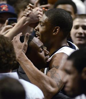 Penn State's Jermaine Marshall (11) is greeted by fans at the end of an NCAA college basketball game against Michigan in State College, Pa., Wednesday, Feb. 27, 2013. Penn State won 84-78. (AP Photo/Ralph Wilson)