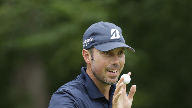 Matt Kuchar waves with his ball after sinking a putt on the fifth hole during the final round of the Colonial golf tournament on Sunday, May 25, 2013, in Fort Worth, Texas. (AP Photo/LM Otero)