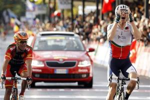 Portugal's Costa celebrates as he crosses the finish to win the men's elite road race ahead of Spain's Rodriguez at UCI Road World Championships in Florence