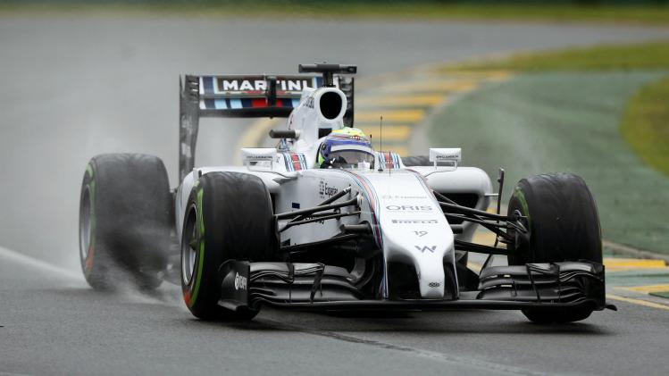 Williams Formula One driver Massa of Brazil takes a corner during the qualifying session for the Australian F1 Grand Prix in Melbourne