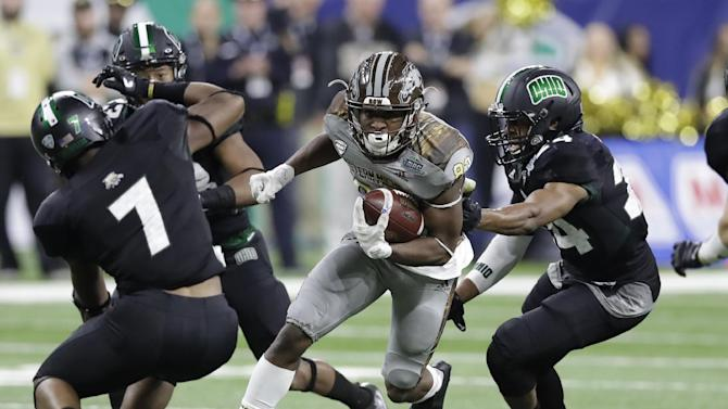 Western Michigan wide receiver Michael Henry runs through the Ohio defense during the first half of the Mid-American Conference championship NCAA college football game, Friday, Dec. 2, 2016, in Detroit. (AP Photo/Carlos Osorio)