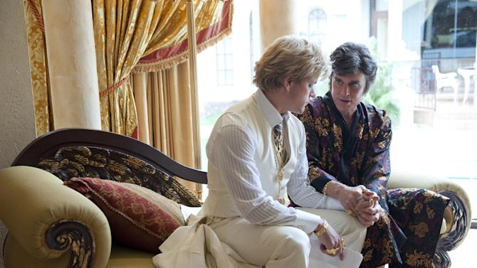 "This film image released by HBO shows Michael Douglas, right, as Liberace, and Matt Damon, as Scott Thorson in a scene from ""Behind the Candalabra,"" a film being shown at the Cannes Film Festival. (AP Photo/HBO, Claudette Barius)"