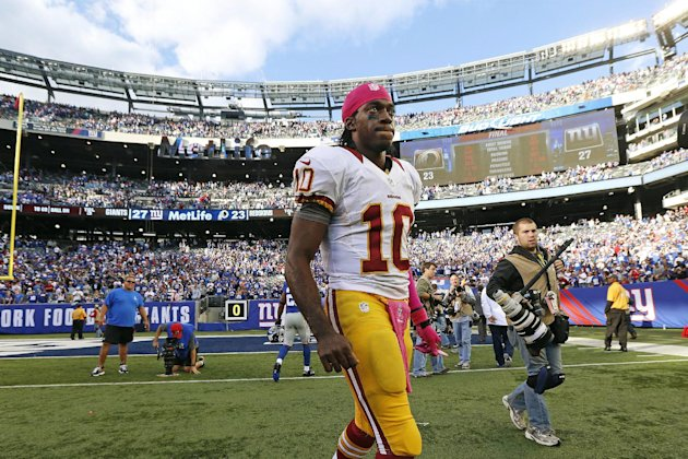 Washington Redskins quarterback Robert Griffin III (10) leaves the field after an NFL football game against the New York Giants, Sunday, Oct. 21, 2012, in East Rutherford, N.J. The Giants won 27-23. (AP Photo/Julio Cortez)