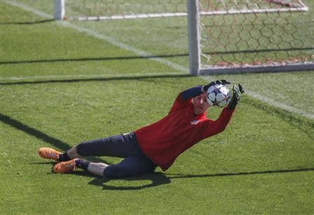 Atletico Madrid's goalkeeper Thibaut Courtois catches the ball during a training session in Madrid