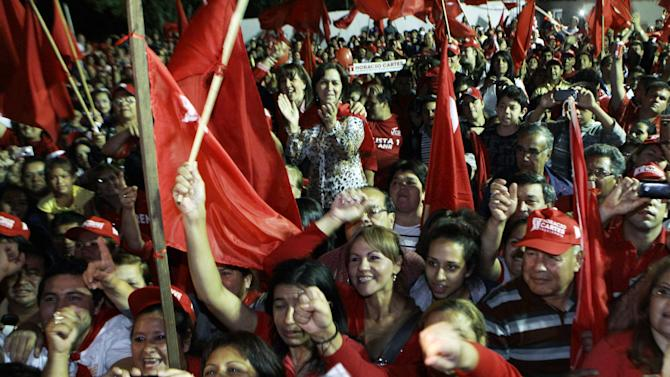 Supporters of Paraguay's Colorado party presidential candidate Horacio Cartes cheer during a campaign rally in Fernando de la Mora, Paraguay, Wednesday, April 17, 2013.  Paraguay will hold general elections on April 21. (AP Photo/Jorge Saenz)
