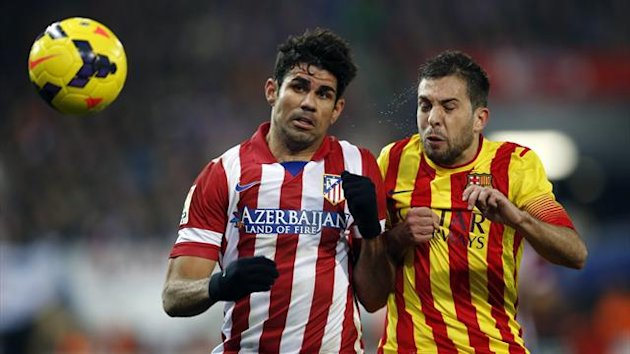 Atletico Madrid's Diego Costa (L) and Barcelona's Jordi Alba fight for the ball during their Spanish first division soccer match at Vicente Calderon stadium in Madrid January 11, 2014 (Reuters)
