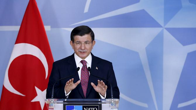 Turkish Prime Minister Davutoglu addresses a news conference after meeting NATO Secretary-General Stoltenberg at the Alliance's headquarters in Brussels