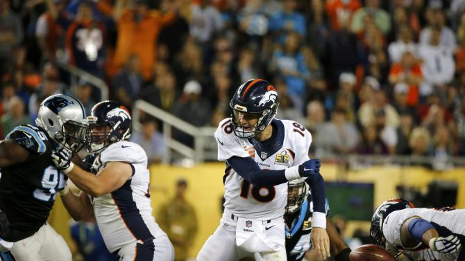 Denver Broncos' quarterback Manning loses the ball after it was knocked out of his hand by Carolina Panthers' Ealy in the fourth quarter of the NFL's Super Bowl 50 football game in Santa Clara