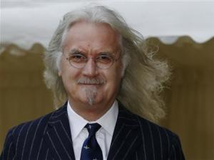 Actor Billy Connolly arrives for a reception for the British Film Industry held by Britain's Queen Elizabeth and Prince Philip at Windsor Castle, southern England