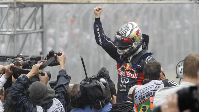Red Bull driver Sebastian Vettel of Germany celebrates after the Formula One Brazilian Grand Prix at the Interlagos race track in Sao Paulo, Brazil, Sunday, Nov. 25, 2012. Vettel finished sixth and became F1's champion for the third time.(AP Photo/Silvia Izquierdo)