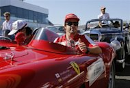 Ferrari Formula One driver Fernando Alonso of Spain gestures during the drivers' parade before the Japanese F1 Grand Prix at the Suzuka circuit October 13, 2013. REUTERS/Toru Hanai