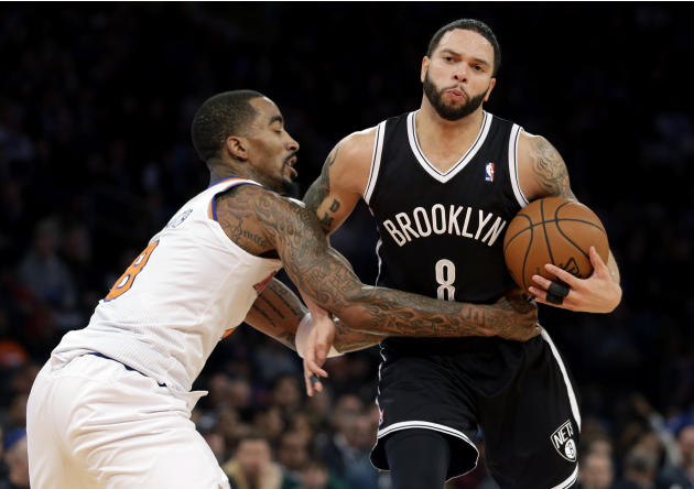 New York Knicks' J.R. Smith, left, fouls Brooklyn Nets' Deron Williams during the second half of the NBA basketball game at Madison Square Garden, Monday, Jan. 20, 2014, in New York. The Nets