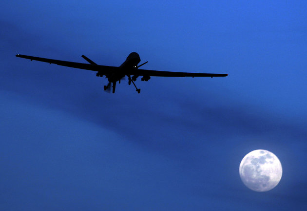 FILE - In this Jan. 31, 2010 file photo, an unmanned U.S. Predator drone flies over Kandahar Air Field, southern Afghanistan, on a moon-lit night. An American citizen killed in a U.S. drone strike in