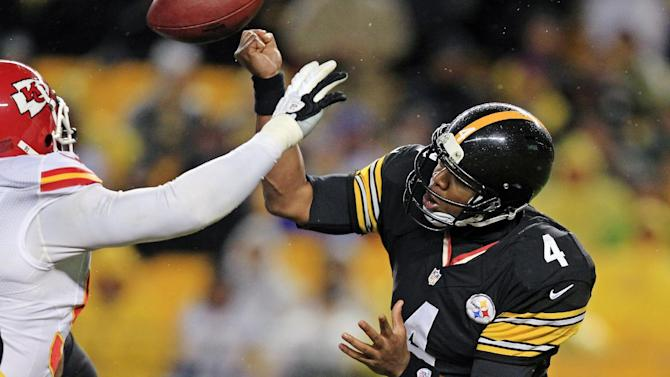 Pittsburgh Steelers quarterback Byron Leftwich (4) has his hand hit by Kansas City Chiefs outside linebacker Tamba Hali, left, as he throws in the third quarter of an NFL football game in Pittsburgh, Monday, Nov. 12, 2012. The Chiefs recovered the ball and went in for an apparent score, but it was overturned and the play was called an incomplete forward pass. (AP Photo/Gene J. Puskar)