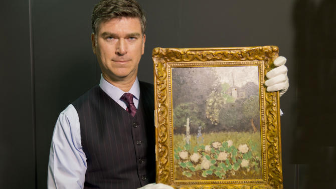 """In this undated image released by The Art Loss Register, Christopher Marinello, Executive Director & General Council of The Art Loss Register, holds a Henri Matisse painting, """"Le Jardin"""" 1920. Le Jardin, or The Garden, was taken from the Museum of Modern Art in Stockholm during a robbery on May 11, 1987 and has been found by an art recovery specialist in London. (AP Photo/Jeremy Young, HO)"""