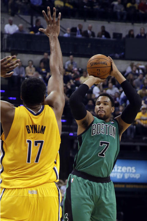 Boston Celtics center Jared Sullinger (7) shoots over Indiana Pacers center Andrew Bynum (17) during the first half of an NBA basketball game in Indianapolis, Tuesday, March 11, 2014. The Pacers won 9
