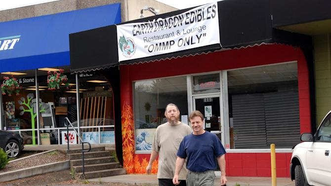 In this April 30, 2012 photo, Michael Shea, left, and Kevin Wallace walk out of their Earth Dragon Edibles Restaurant & Lounge in Ashland, Ore. Medical marijuana patients have to pay for the food, but the hashish-infused oil poured over the stir-fry is free, as is the hashish available for smoking at the bar. (AP Photo/Jeff Barnard)