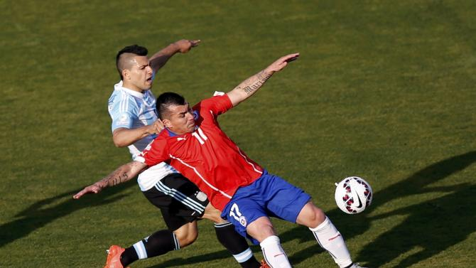 Argentina's Aguero challenges Chile's Medel during their Copa America 2015 final soccer match at the National Stadium in Santiago