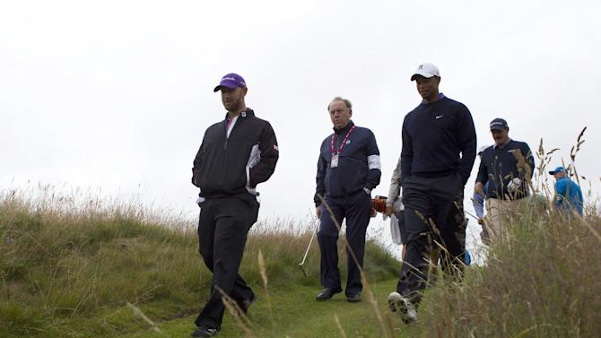 Tiger Woods of the United States, third left, walks down a fairway during a practice round at Royal Lytham & St Annes golf club ahead of the British Open Golf Championship, Lytham St Annes, England, Tuesday, July  17, 2012. (AP Photo/Tim Hales)