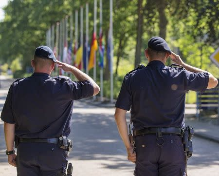 Soldiers observe minute's silence as they pay tribute to victims killed in Malaysia Airlines flight MH17 plane crash at gate of Korporaal van Oudheusden barracks, in Hilversum