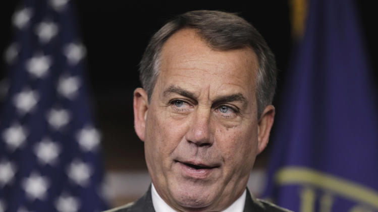 House Speaker John Boehner of Ohio tells reporters on Capitol Hill in Washington, Thursday, Sept. 22, 2011, that there will not be a government shutdown despite the failure yesterday of the continuing resolution. He also asserted that President Obama's trip today to Ohio, Boehner's home state, was a political game.  (AP Photo/J. Scott Applewhite)