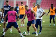 Chelsea manager Jose Mourinho (right) supervises a training session at the Rajamangala stadium in Bangkok, on July 16, 2013. Thailand have denied a father's claim that a boy chosen as a Chelsea mascot was forced to make way for the prime minister's football-mad son