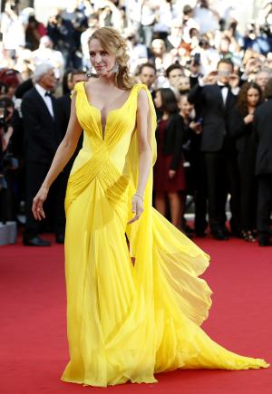Actress Uma Thurman arrives for the screening of Sils Maria at the 67th international film festival, Cannes, southern France, Friday, May 23, 2014. (AP Photo/Alastair Grant)