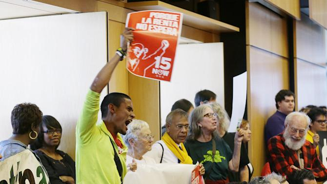 supporters of Seattle's $15 minimum wage measure