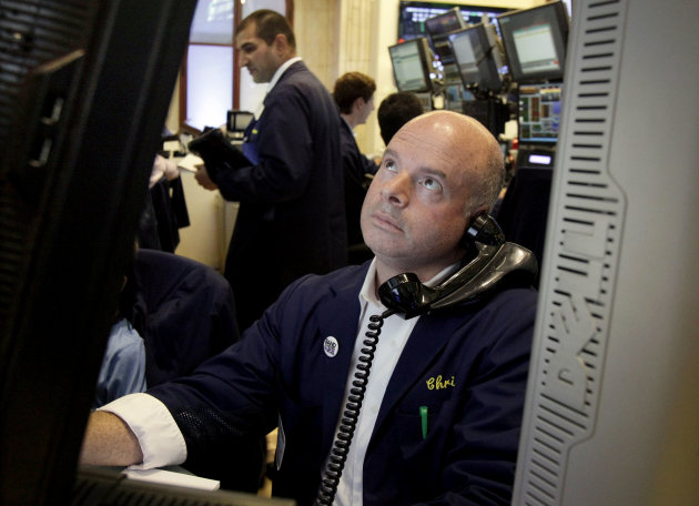 FILE - In this July 3, 2012 file photo, a trader studies his screen as he works on the floor of the New York Stock Exchange. U.S. stock futures fluctuated in volatile trading Thursday, July 5, 2012, as banks in China and Europe took action to bolster flagging economies and poor retail sales for June offset some promising job numbers from the Labor Department. (AP Photo/Richard Drew, File)