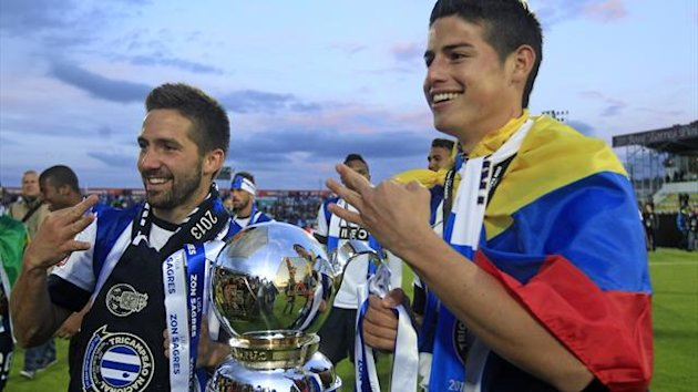 Moutinho (left) and Rodriguez pose with the Portuguese league trophy (Reuters)